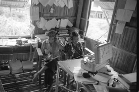 Itolina and Mabok listening to their tape recordings in the office of the research station (1962).
